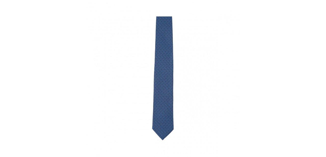Corbata azul con anagrama tricolor