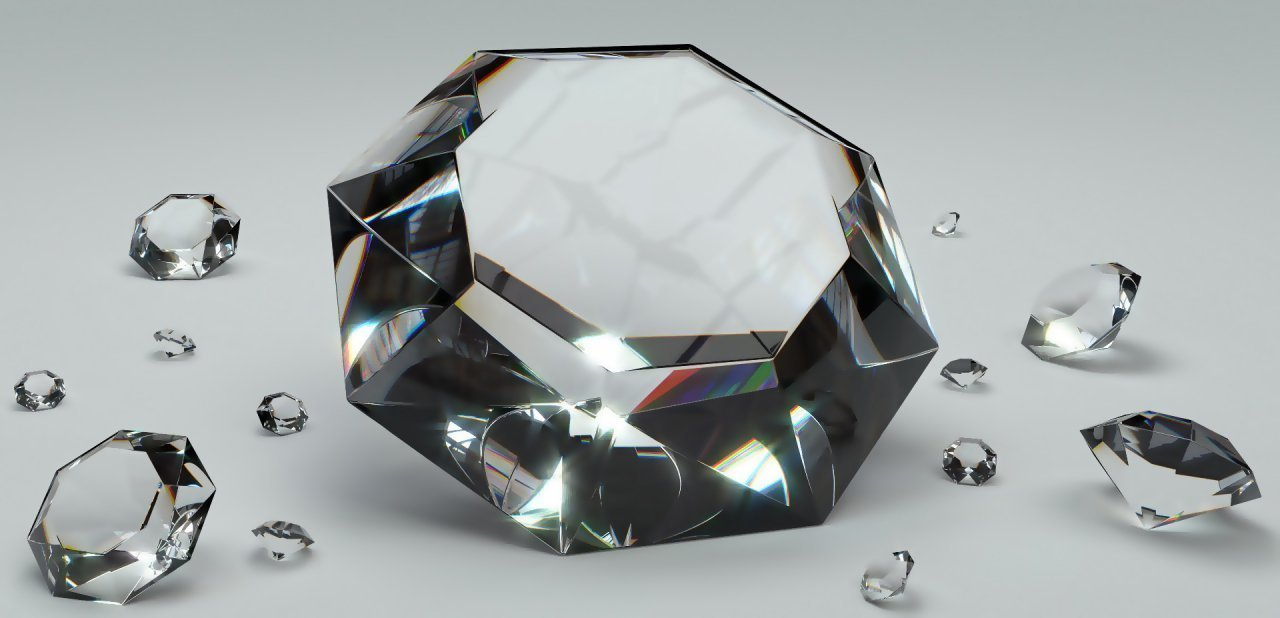 Diferentes diamantes dispuestos sobre una superficie