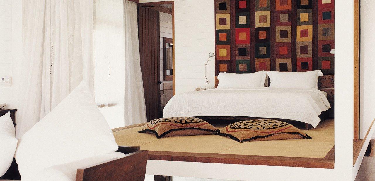 Habitación dentro de un bungalow del Cocoa Island Resort